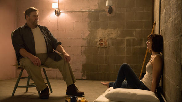 John Goodman as Howard; Mary Elizabeth Winstead as Michelle in 10 CLOVERFIELD LANE; by Paramount Pictures