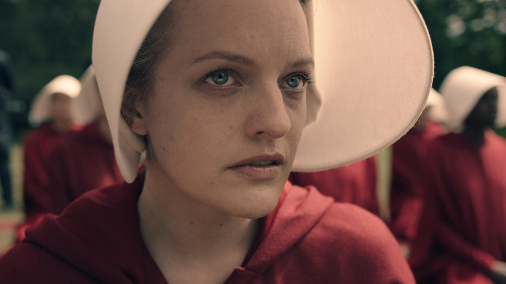 THE HANDMAID'S TALE -- The drama series, based on the award-winning, best-selling novel by Margaret Atwood, is the story of life in the dystopia of Gilead, a totalitarian society in what was formerly part of the United States. Facing environmental disasters and a plunging birthrate, Gilead is ruled by a fundamentalist regime that treats women as property of the state. As one of the few remaining fertile women, Offred (Elisabeth Moss) is a Handmaid in the Commander's household, one of the caste of women forced into sexual servitude as a last desperate attempt to repopulate a devastated world. In this terrifying society where one wrong word could end her life, Offred navigates between Commanders, their cruel Wives, domestic Marthas, and her fellow Handmaids – where anyone could be a spy for Gilead – all with one goal: to survive and find the daughter that was taken from her. Offred (Elisabeth Moss), shown. (Photo by: Take Five/Hulu)